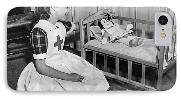 A Young Girl Plays Nurse To Her Little Lulu Doll. IPhone Case by Underwood Archives