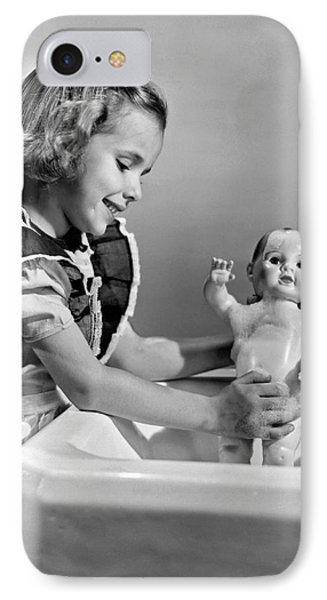 A Young Girl Plays With Her New All-vinyl Plastic Doll That Can IPhone Case