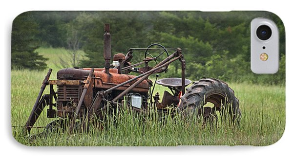 Abandoned Farm Tractor In The Grass Phone Case by Randall Nyhof