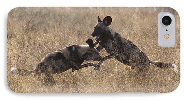 IPhone Case featuring the photograph African Wild Dogs Play-fighting by Liz Leyden