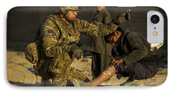 Airman Provides Medical Aid To A Local Phone Case by Stocktrek Images