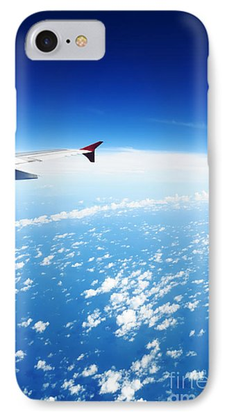 Airplane Wing Against Blue Sky Horizon Phone Case by William Voon