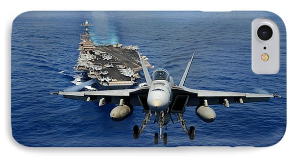 IPhone Case featuring the photograph An Fa-18 Hornet Demonstrates Air Power. by Paul Fearn