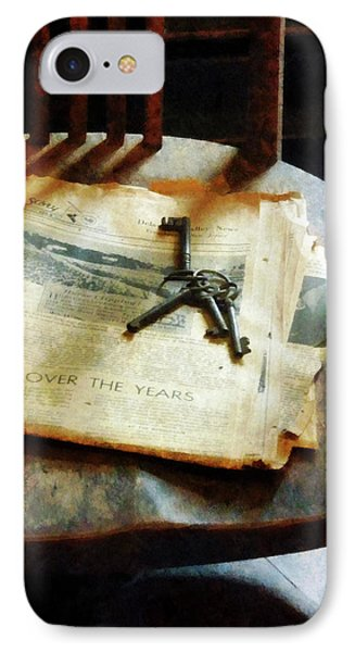 IPhone Case featuring the photograph Antique Keys On Newspaper by Susan Savad