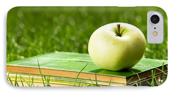 Apple On Pile Of Books On Grass Phone Case by Michal Bednarek
