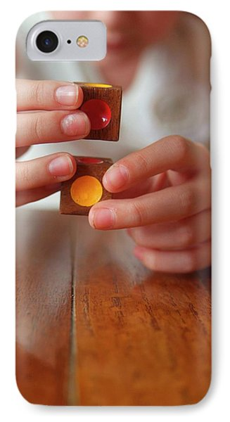 Autistic Girl Playing With Toy Blocks IPhone Case by Hannah Gal