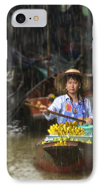 IPhone Case featuring the photograph Banana Vendor In The Rain by Rob Tullis