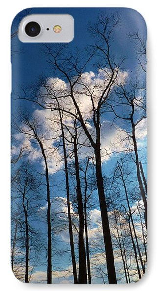 IPhone Case featuring the photograph Bare Trees Fluffy Clouds by Jeanette Oberholtzer