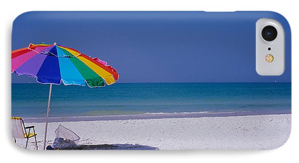 Beach Umbrella And A Folding Chair IPhone Case by Panoramic Images