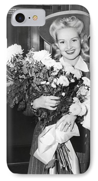 Betty Grable With Flowers IPhone Case by Underwood Archives