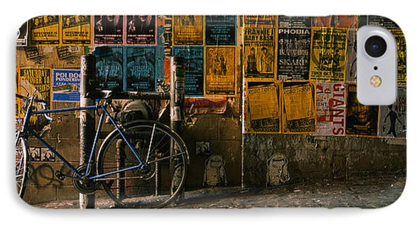 Bicycle Leaning Against A Wall IPhone Case by Panoramic Images