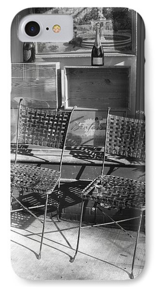 IPhone Case featuring the photograph Bistro Chairs In Black And White by Margie Avellino