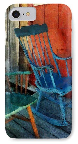 Blue Chair Against Red Door Phone Case by Susan Savad