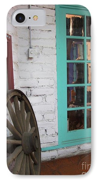 IPhone Case featuring the photograph Blue Window And Wagon Wheel by Dora Sofia Caputo Photographic Art and Design