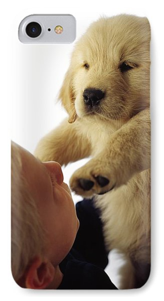 Boy Holding Puppy Up Phone Case by Ron Nickel
