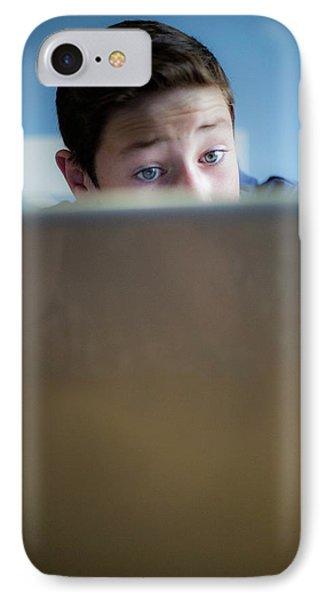 Boy Using A Laptop IPhone Case by Samuel Ashfield