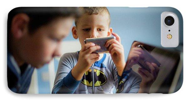 Boy Using Smartphone IPhone Case by Samuel Ashfield