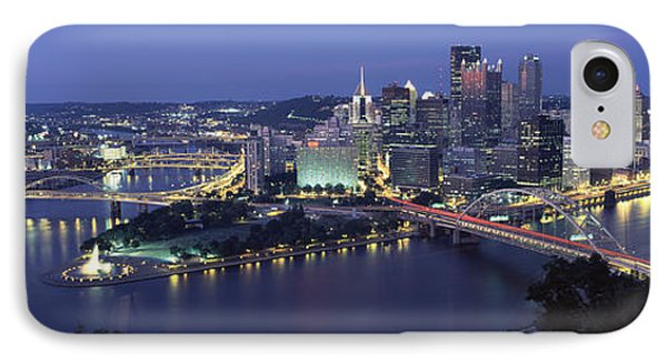 Buildings Along A River Lit Up At Dusk IPhone Case by Panoramic Images