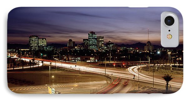 Buildings In A City Lit Up At Dusk, 7th IPhone Case by Panoramic Images