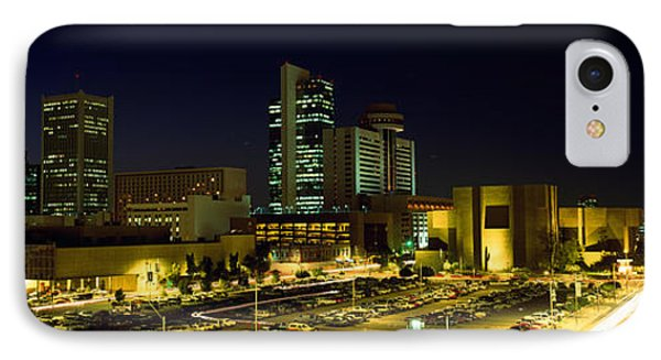 Buildings In A City Lit Up At Night IPhone Case by Panoramic Images