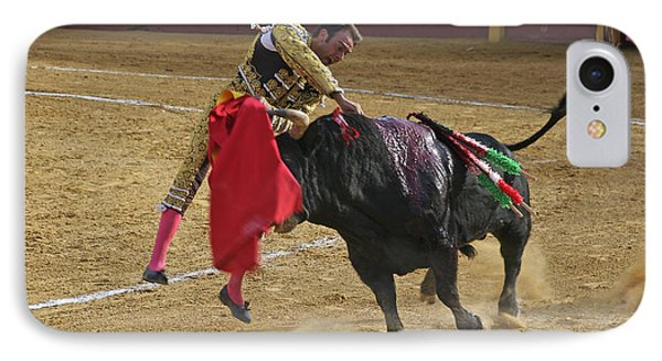 Bullfighter Manuel Ponce Performing The Estocada To Kill The Bull IPhone Case by Perry Van Munster