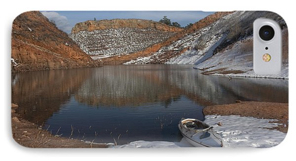 canoe and Colorado mountain lake in early spring IPhone Case
