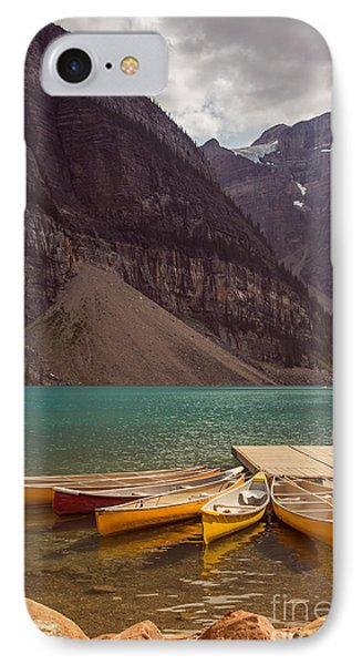 Canoe For Rent In Banff's Moraine Lake IPhone Case by Edward Fielding