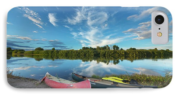 Canoes With Clouds Reflecting  IPhone Case by Yva Momatiuk John Eastcott