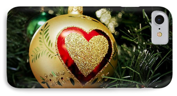 IPhone Case featuring the photograph Christmas Gold Ball With Heart by Maria Janicki