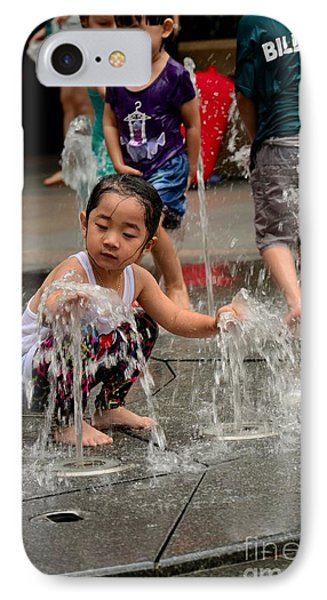 Clothed Children Play At Water Fountain IPhone Case by Imran Ahmed