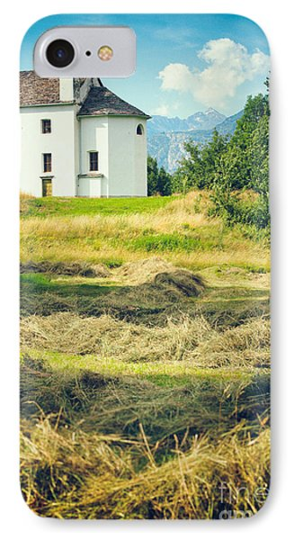 IPhone 7 Case featuring the photograph Country Church With Hay by Silvia Ganora