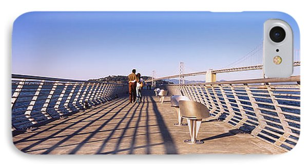 Couple Walking On A Pier, Bay Bridge IPhone Case by Panoramic Images