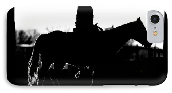 IPhone Case featuring the photograph Cowboy Rides Home In Silhouette by Lincoln Rogers