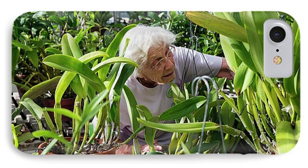 Elderly Woman Examining Plants IPhone 7 Case by Jim West