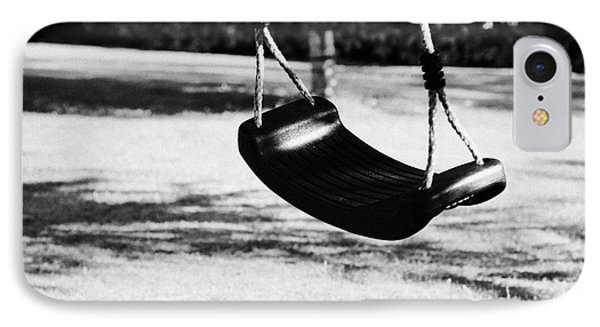 Empty Plastic Swing Swinging In A Garden In The Evening IPhone Case