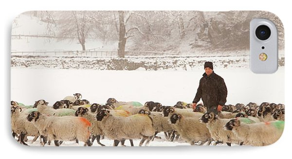 Farmer Feeding Sheep In Winter IPhone Case by Ashley Cooper
