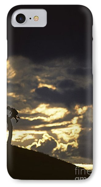 Father Holding Daughter Above His Head Along Hillside Silhouette IPhone Case