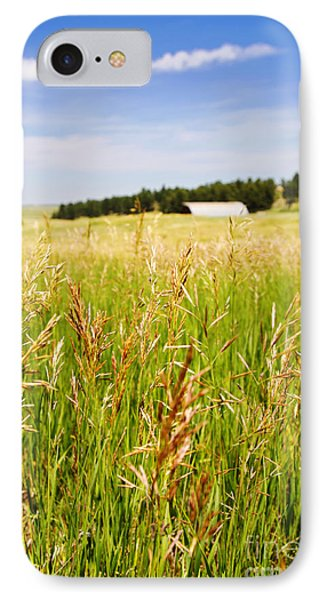 IPhone Case featuring the photograph Field Of Brome Grass With Barn by Lincoln Rogers