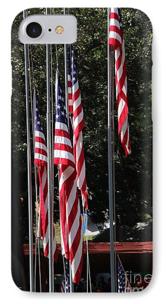 IPhone Case featuring the photograph Flags Are Coming Down by Yumi Johnson