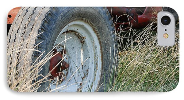 IPhone Case featuring the photograph Ford Tractor Tire by Jennifer Ancker