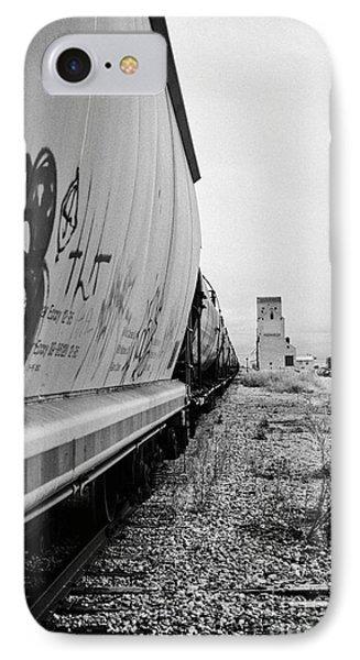 freight grain trucks on canadian pacific railway through assiniboia Saskatchewan Canada IPhone Case by Joe Fox