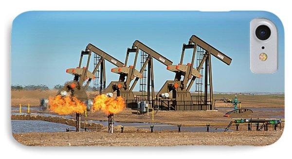 Gas Flares And Pumps At An Oil Field IPhone Case