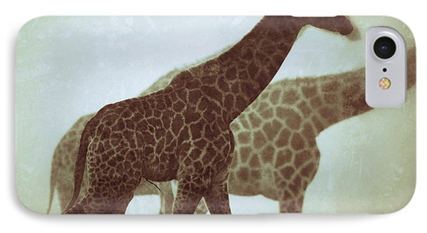 IPhone Case featuring the photograph Giraffes In The Mist by Nick  Biemans