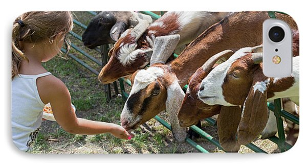 Girl Feeding Goats IPhone Case by Jim West