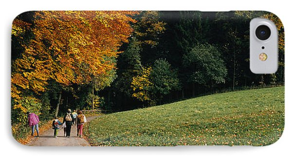 Group Of People Walking On A Walkway IPhone Case by Panoramic Images