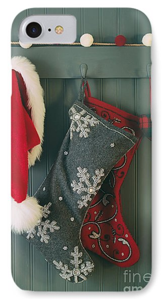 IPhone Case featuring the photograph Hanging Stockings And Santa Hat On Hook by Sandra Cunningham