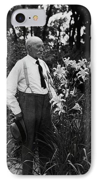 Hans Peter Sass Standing Beside A Flowering Plant IPhone Case by Fleeta Brownell Woodroffe