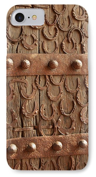 Horseshoes Decorate A Wooden Door, Jama IPhone Case by Inger Hogstrom