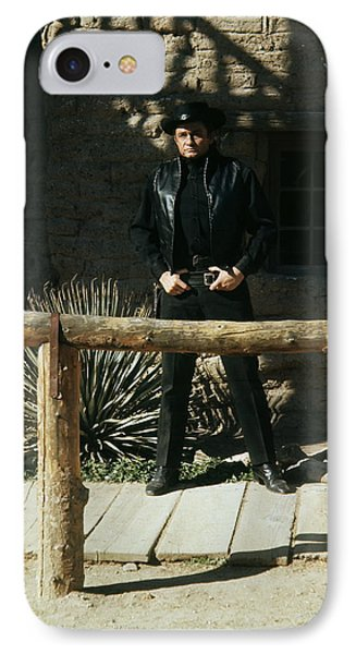 IPhone Case featuring the photograph Johnny Cash Gunfighter Hitching Post Old Tucson Arizona 1971 by David Lee Guss