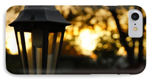 IPhone Case featuring the photograph Lamplight by Photographic Arts And Design Studio